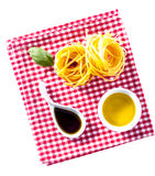Uncooked fettucini pasta with soy sauce and oil Royalty Free Stock Photo