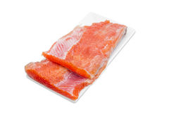 Uncooked fillet of rainbow trout on a rectangular dish Royalty Free Stock Images