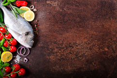Uncooked fish on dark vintage background. Free space for your text. Royalty Free Stock Photo