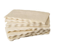 Uncooked flaky dough slices Stock Photos