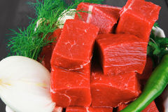 Uncooked fresh beef meat chunks on white bowls Royalty Free Stock Photos
