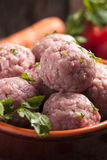 Uncooked Fresh Meatballs. With vegetables stock photo