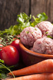 Uncooked Fresh Meatballs. With vegetables stock image