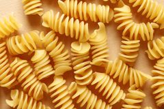 Uncooked fusilli pasta as background, closeup stock images