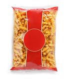 Uncooked fusilli pasta in plastic bag on white background royalty free stock images