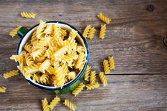 Uncooked fusilli pasta. Uncooked raw italian fusilli pasta in rustic metal mug with copy space - healthy ingredient for cooking stock photo