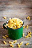 Uncooked fusilli pasta. Uncooked raw italian fusilli pasta in rustic metal mug - healthy ingredient for cooking stock images