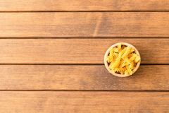 Uncooked fusilli pasta . Wooden background . Italian Food . Empt. Y space for text Royalty Free Stock Photo