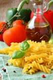 Uncooked gluten free fusilli pasta from blend of corn and rice flour.  royalty free stock image