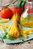 Uncooked gluten free pasta from blend of corn and rice flour Royalty Free Stock Photo