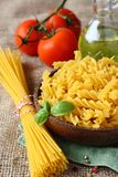 Uncooked gluten free pasta from blend of corn and rice flour Royalty Free Stock Photos