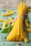 Uncooked gluten free pasta from blend of corn and rice flour Stock Photography