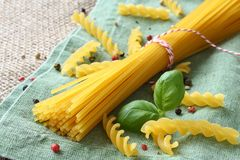 Uncooked gluten free pasta from blend of corn and rice flour Stock Photos