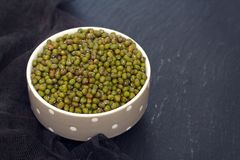 Uncooked green soya in bowl Stock Photos
