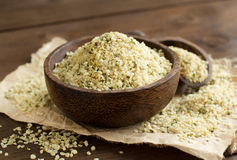 Uncooked Hemp seeds in a bowl with a spoon. Pile of Uncooked Hemp seeds in a bowl with a spoon royalty free stock photo