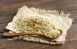 Uncooked Hemp seeds with a spoon. Pile of Uncooked Hemp seeds with a spoon close up royalty free stock photo