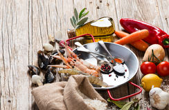 Uncooked ingredients of seafood paella Stock Photography
