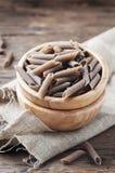 Uncooked italian buckwheat pasta on the wooden table Stock Photography