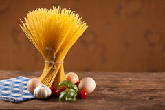 Uncooked Italian dried spaghetti tied with string. Royalty Free Stock Image