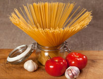 Uncooked Italian dried spaghetti tied with string. Royalty Free Stock Photos