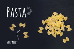 Uncooked Italian pasta Farfalle on black slate stone background Stock Photo