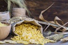 Uncooked Italian pasta Farfalle, Elbow macaroni and Fusilli Stock Images