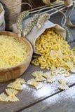 Uncooked Italian pasta Farfalle, Elbow macaroni and Fusilli Royalty Free Stock Photography