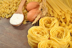 Uncooked Italian pasta, flour and eggs Stock Photography