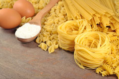 Uncooked Italian pasta, flour and eggs Royalty Free Stock Photography