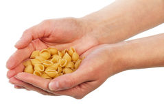 Uncooked italian pasta in hands Stock Images