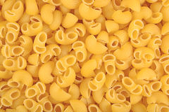 Uncooked italian pasta pipe rigate as background Royalty Free Stock Images