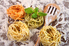 Uncooked Italian pasta in three colors Royalty Free Stock Image