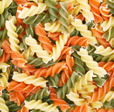 Uncooked italian pasta - three colors spirals Royalty Free Stock Photos