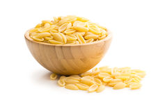 Uncooked italian pasta in wooden bowl Royalty Free Stock Image