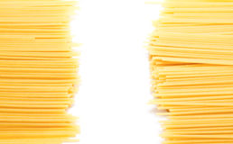 Uncooked Italian spaghetti isolated on a white Stock Images