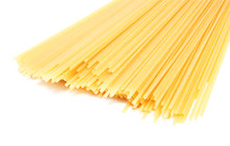 Uncooked Italian spaghetti isolated on a white Royalty Free Stock Photography