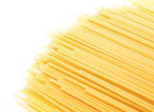 Uncooked Italian spaghetti isolated on a white Stock Photography