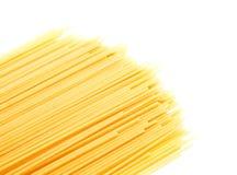 Uncooked Italian spaghetti isolated on a white Stock Photos