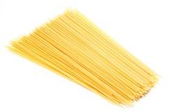 Uncooked Italian spaghetti isolated Stock Photos