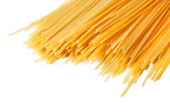 Uncooked Italian spaghetti on a white. Royalty Free Stock Images