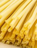 Uncooked Italian spaghetti on a white background Royalty Free Stock Photos