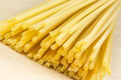 Uncooked Italian spaghetti on a white background Stock Images