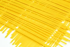 Uncooked Italian spaghetti on a white background Stock Photo