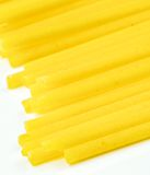 Uncooked Italian spaghetti on a white background Royalty Free Stock Photo