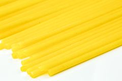 Uncooked Italian spaghetti on a white background Royalty Free Stock Image