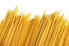 Uncooked Italian spaghetti on a white background. Stock Images
