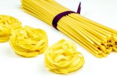 Uncooked Italian tagliatelle and spaghetti pasta Royalty Free Stock Image