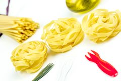 Uncooked Italian tagliatelle and spaghetti pasta Royalty Free Stock Images