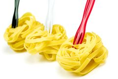 Uncooked Italian tagliatelle on a white background Royalty Free Stock Images