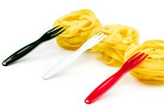 Uncooked Italian tagliatelle on a white background Royalty Free Stock Photography